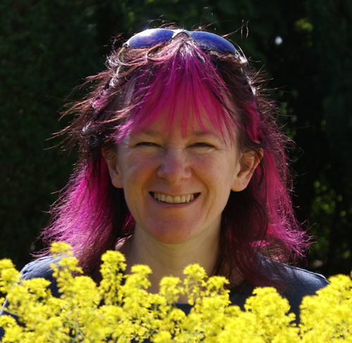 Debbie in the garden with her woad plants