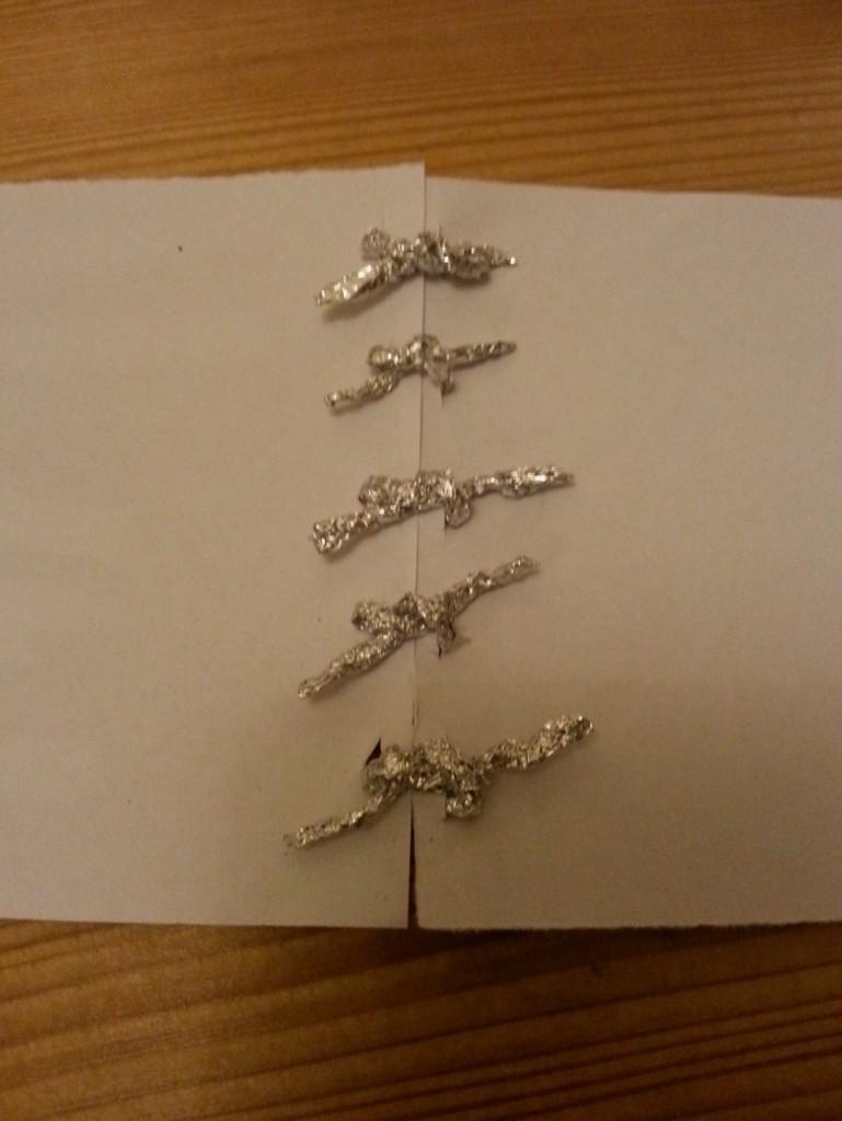 Paper with aluminium cords