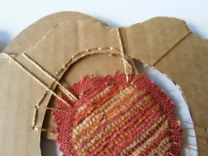 Cardboard, fabric and metallic thread