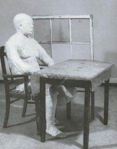 man sitting at a table - George Segal