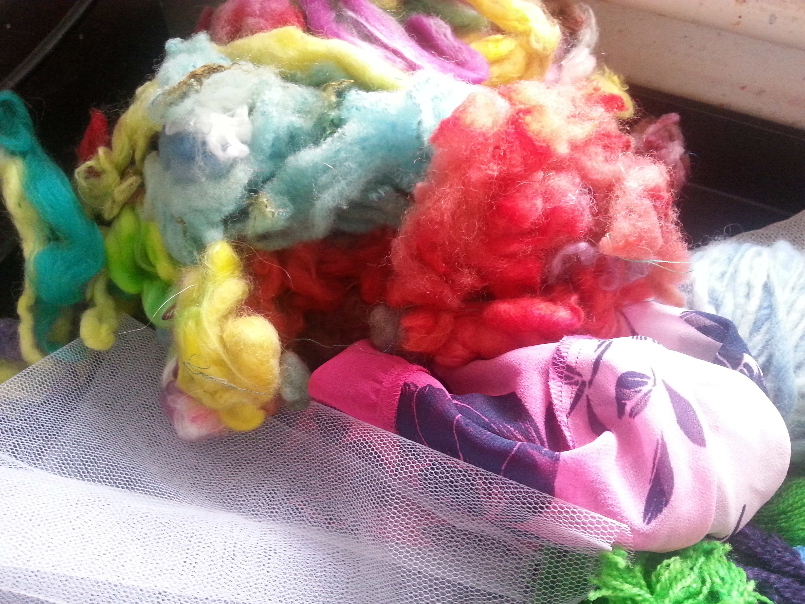 Raw hand-dyed wool ready for felting